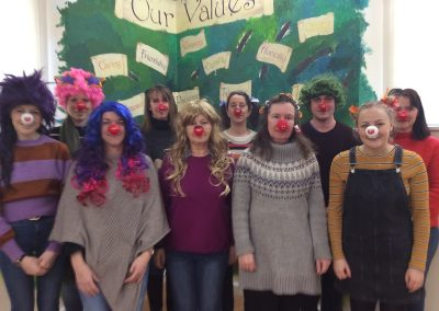 The staff with their red noses and mad hair.