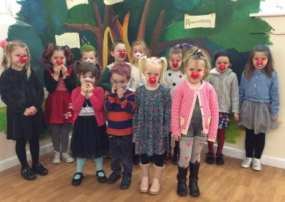 Reception with their red noses and mad hair.