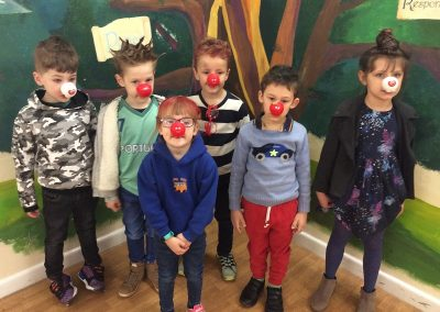 Year 1 with their red noses and mad hair.