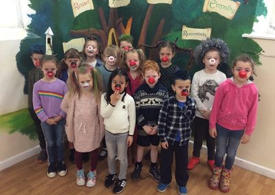 Year 2 with their red noses and mad hair.