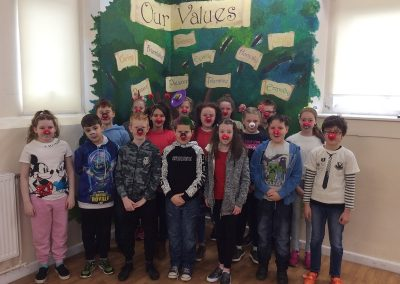 Year 6 with their red noses and mad hair.