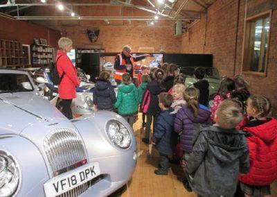Children having a tour of the Morgan Motor factory.